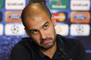 Barcelona soccer coach Guardiola speaks to reporters during a news conference at Parken stadium in Copenhagen